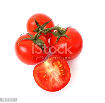 Sprig Of Ripe Tomato On White Background A Half Of A Tomato Close Up Juicy Ripe Vegetables Stock Photo & More Pictures of Agriculture