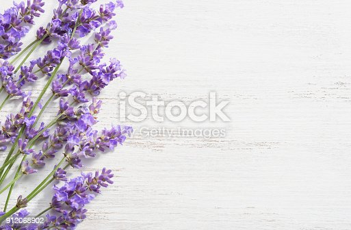 istock Sprigs of lavender on  wooden shabby background. 912068902