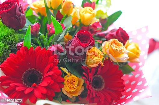 1129427811 istock photo Spring bouquet of flowers in stylish hat box on white table. Beautiful bouquet of colorful flowers in hat box. 1160254072