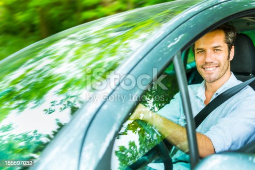 1051147634 istock photo Spring break; driving in a forest 155597032