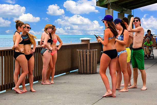 spring break students on clearwater beach pier florida - beautiful college girl pics stock photos and pictures