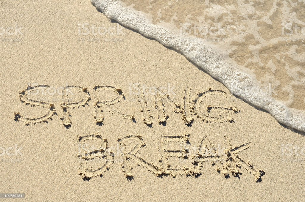 Spring Break Written in the Sand on a Beach stock photo