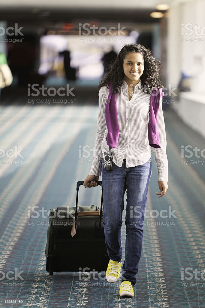 Spring Break - Young female airport traveler royalty-free stock photo
