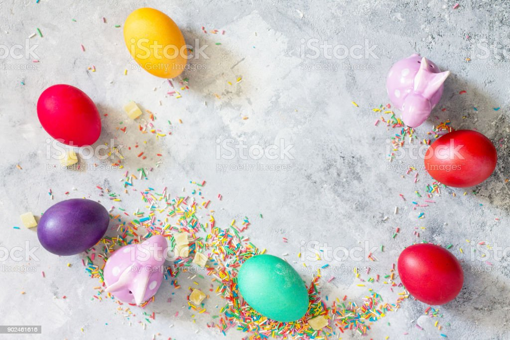 Spring concept. Colorful background of Easter with colored eggs on a concrete background with copy space. Flat lay. Top view with copy space. stock photo