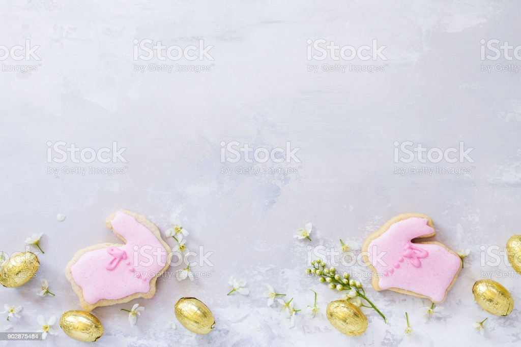 Spring concept. Colorful Easter background with colored eggs and Easter baking on a gray stone background with copy space. Flat lay. Top view with copy space. stock photo