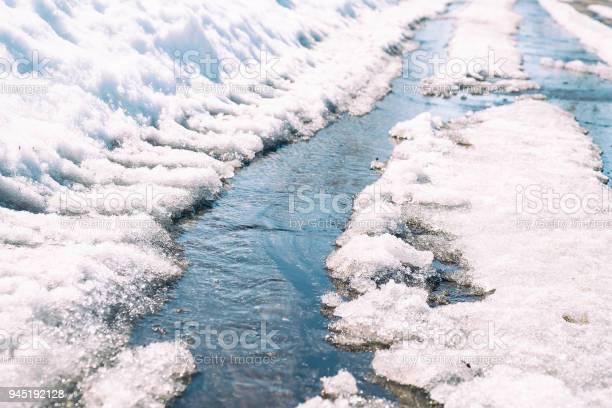 Photo of Spring creek flows through the asphalt