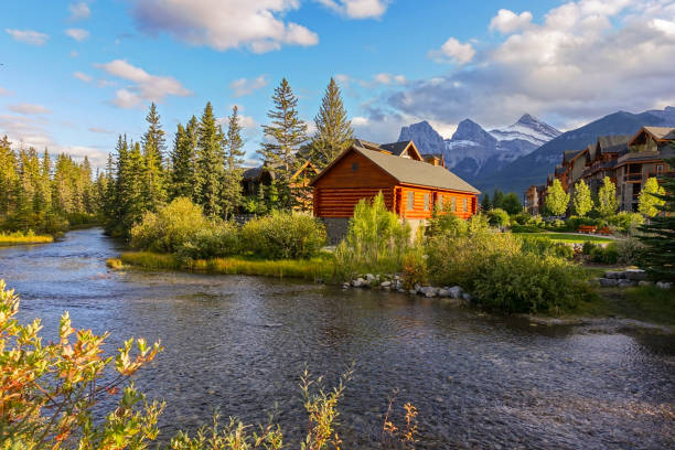 Spring Creek Mountain Village Autumn Colors Three Sisters Mountain Canmore Alberta Canada stock photo