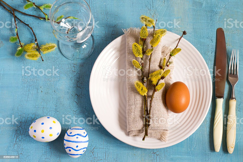 Spring Easter Table setting on a wooden table. Top view. stock photo