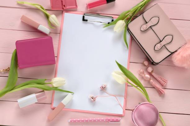 spring fashion flat lay. spring to do list.blank blackboard, cosmetics, accessories, handbags in pink ones, white tulips on a pink wooden background.top view, copy space. - spring fashion stock pictures, royalty-free photos & images