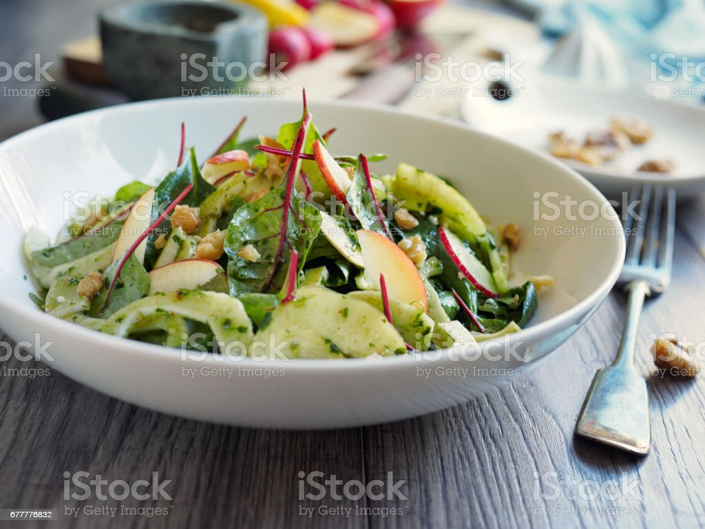 Spring fennel,red chard and radish apple salad stock photo