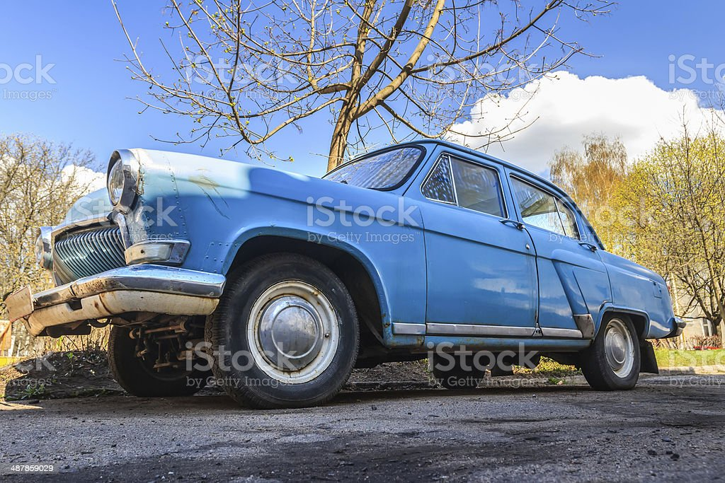 Spring fever of  navy blue classic car in back yard stock photo