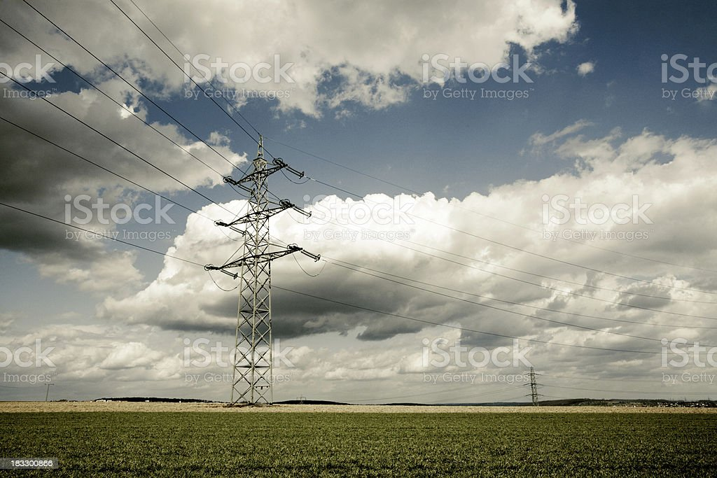 spring field dramatic clouds royalty-free stock photo