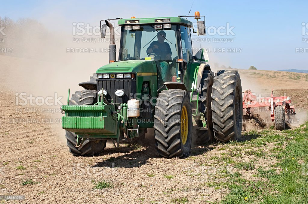 Spring field with tractor royalty-free stock photo