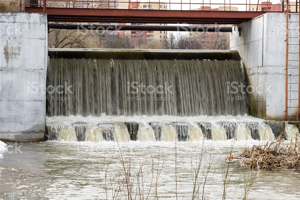 Spring flood on the river dam. High water stock photo