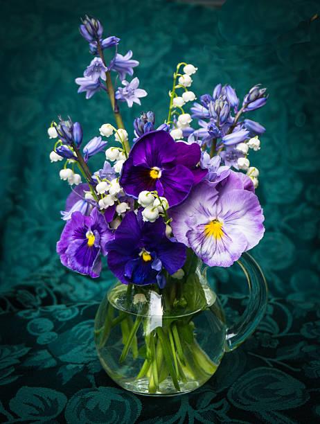 spring flower bouquet on dark green background stock photo
