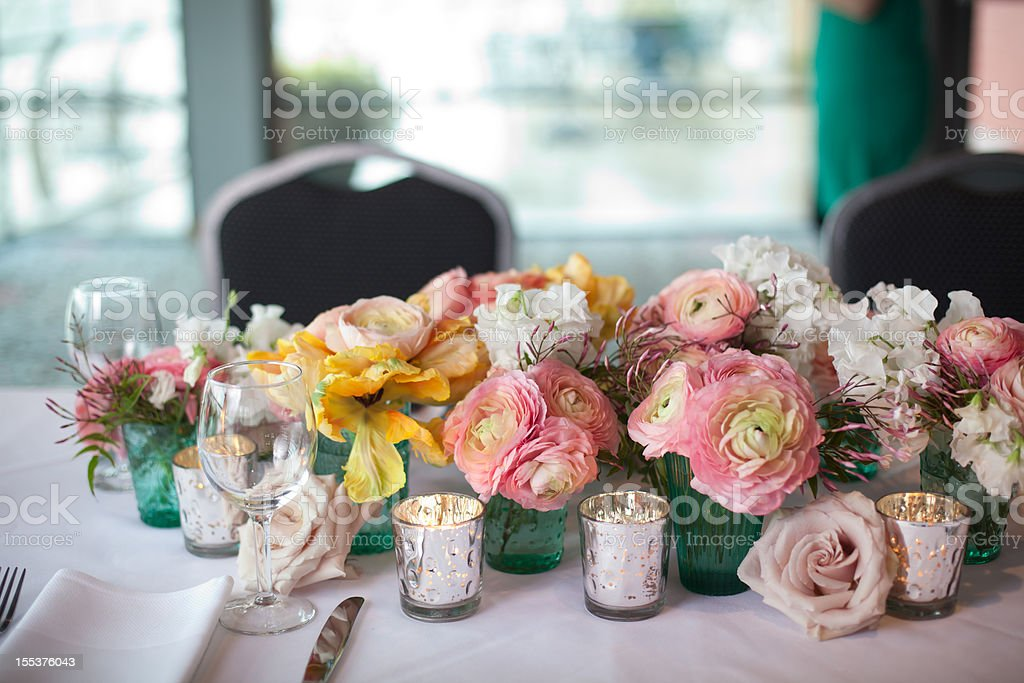 Spring flower centerpiece on dining table stock photo