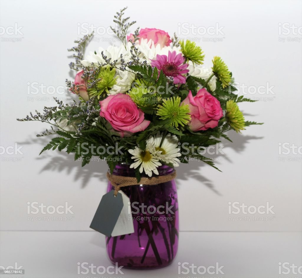 Spring Flowers in a Purple Vase - Royalty-free Bouquet Stock Photo