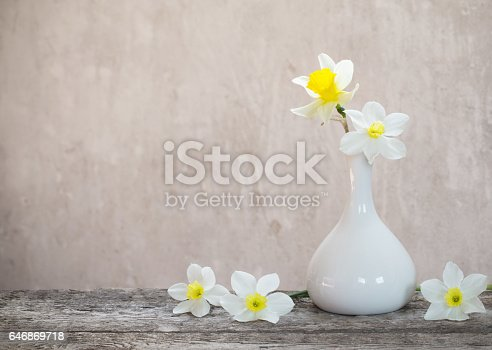 istock spring flowers on old background 646869718
