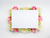 Festive flower concept : beautiful floral border on the white  background with copy space.  Flat lay.