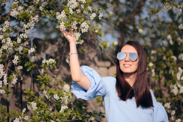 Spring Girl Wearing Sunglasses in Outdoor Fashion Portrait stock photo