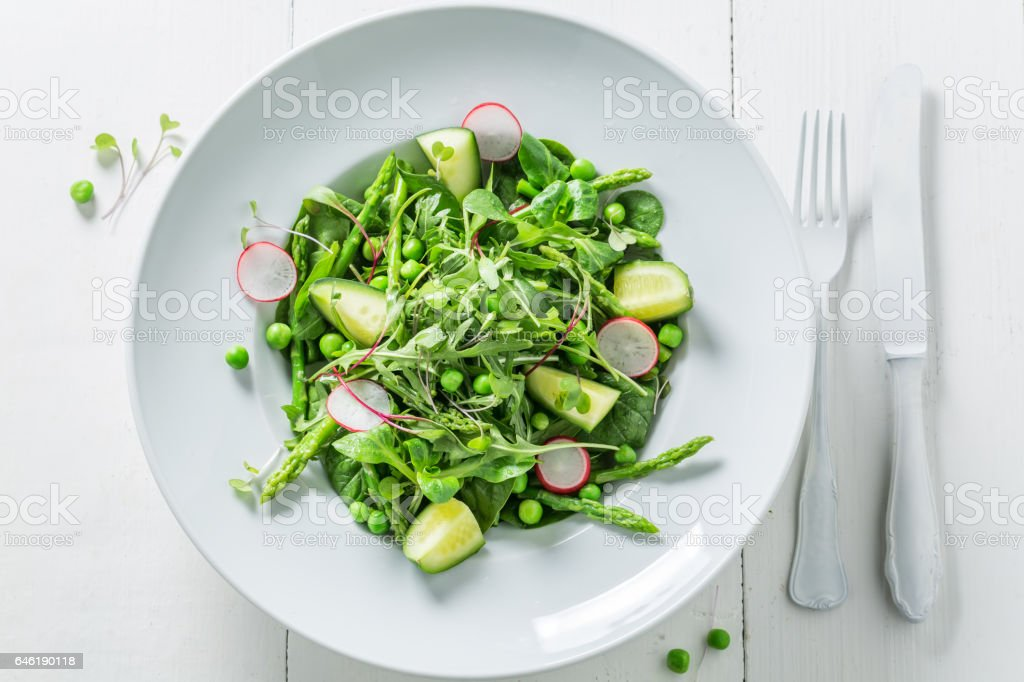 Spring green salad with spinach, radishes and asparagus stock photo