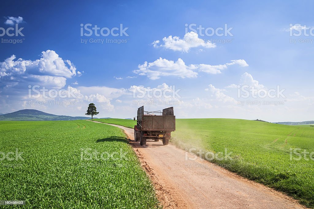 Spring Landscape - Country road and Green Fields stock photo
