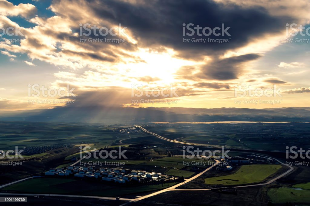 Spring Landscape Beautiful sun lighted terrain on a spring day Agricultural Field Stock Photo