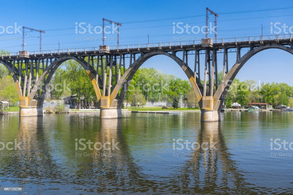 Spring landscape with classic arched bridge and it's reflection stock photo