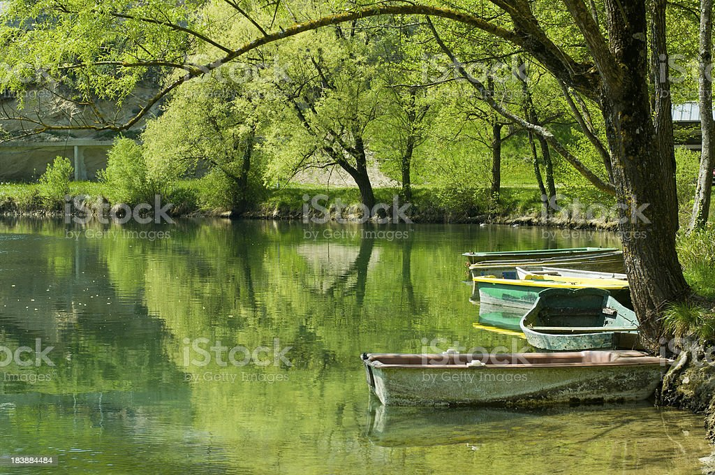 Spring landscape with Pond and Boats royalty-free stock photo
