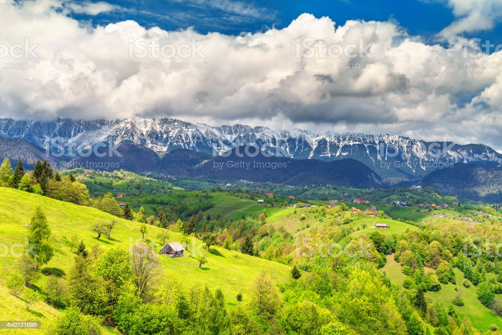 Spring landscape with snowy mountains near Brasov, Transylvania, Romania, Europe stock photo