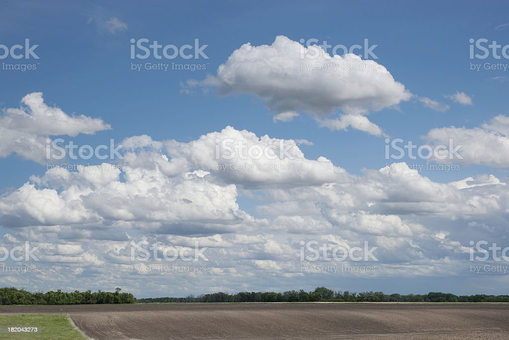 spring landscape-cloudscape over field royalty-free stock photo