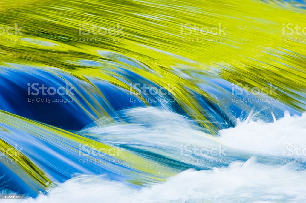 Spring leaves reflected in a stream royalty-free stock photo