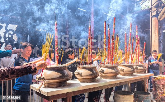 Ho Chi Minh City, Vietnam - February 8th, 2016: Spring lively atmosphere at the temple with hundreds of pilgrims to pray for peace as this incense ethnic traditions of New Year's Day in Ho Chi Minh City, Vietnam