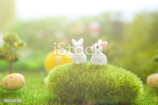 Spring meadow with a rabbit and easter egg. Fairy tale