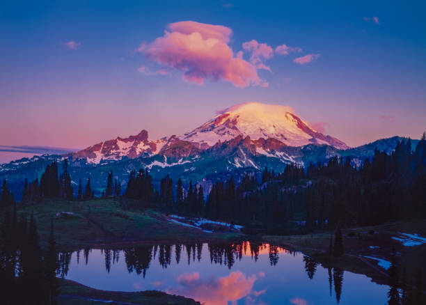 Spring morning in the Cascade Range with reflection of Mount Rainier, WA vacation get away; getting away from it all; travel adventure; mountain wonderland mt rainier stock pictures, royalty-free photos & images