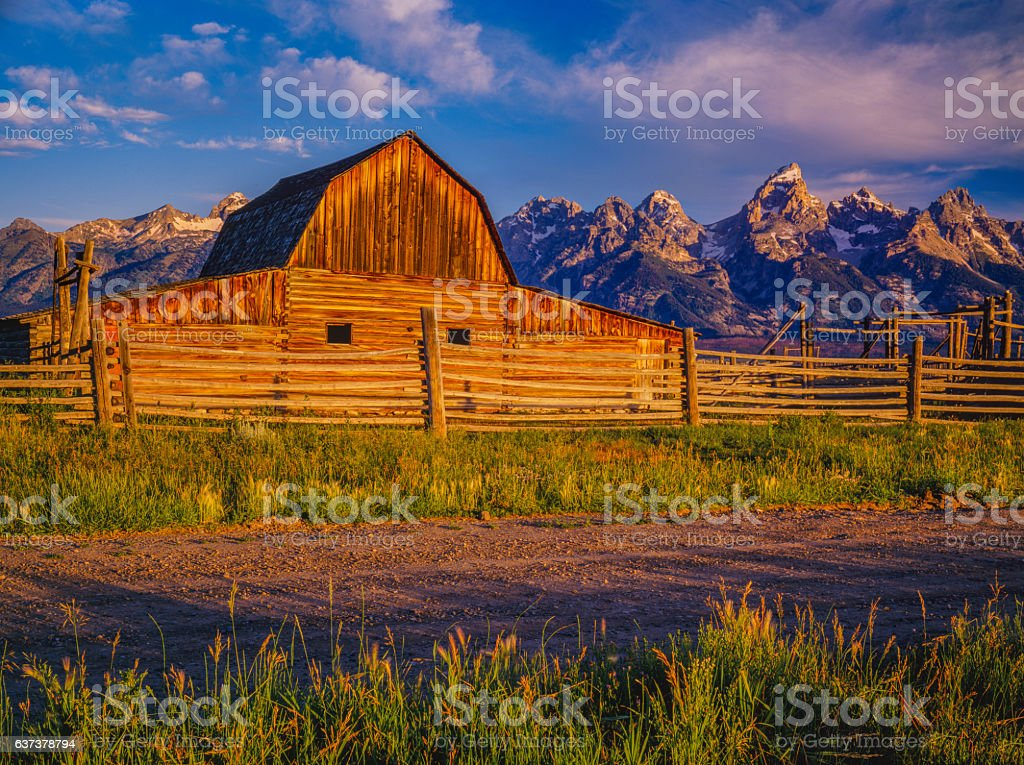 Spring morning log barn Grand Teton National Park,WY(P) stock photo