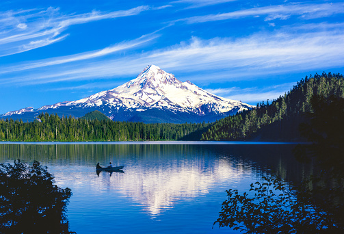 Spring morning at Trillium Lake with Mt. Hood reflection in the deep blue rippling water