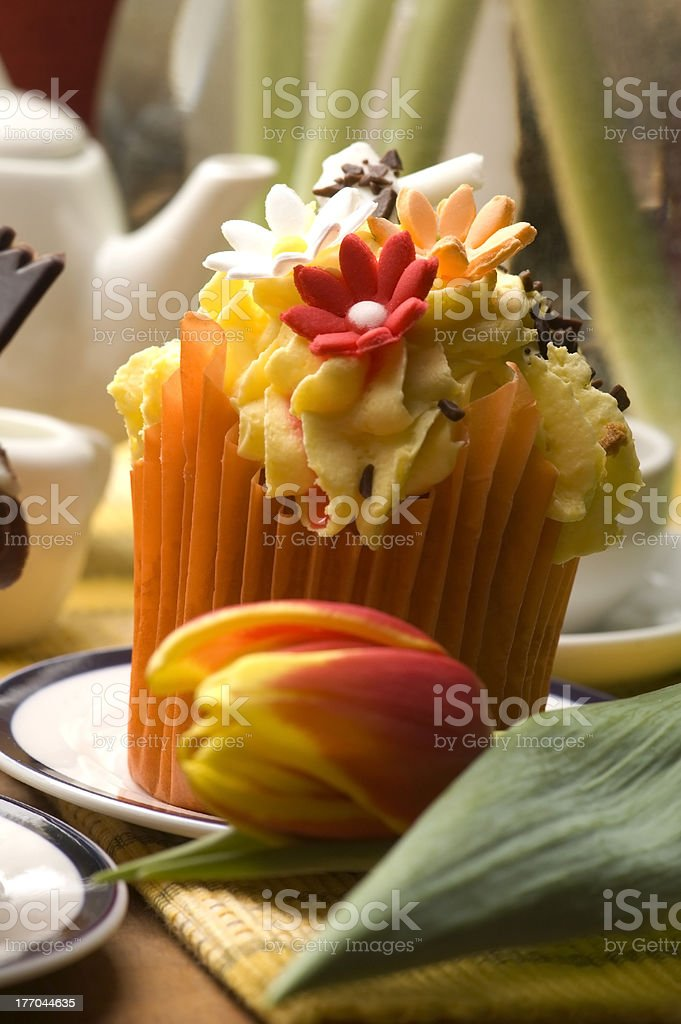 Spring muffins decorated with flowers royalty-free stock photo