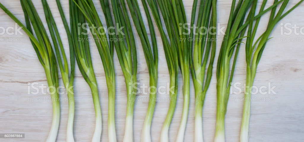 Spring onions ,green onions or scallions on wood background stock photo