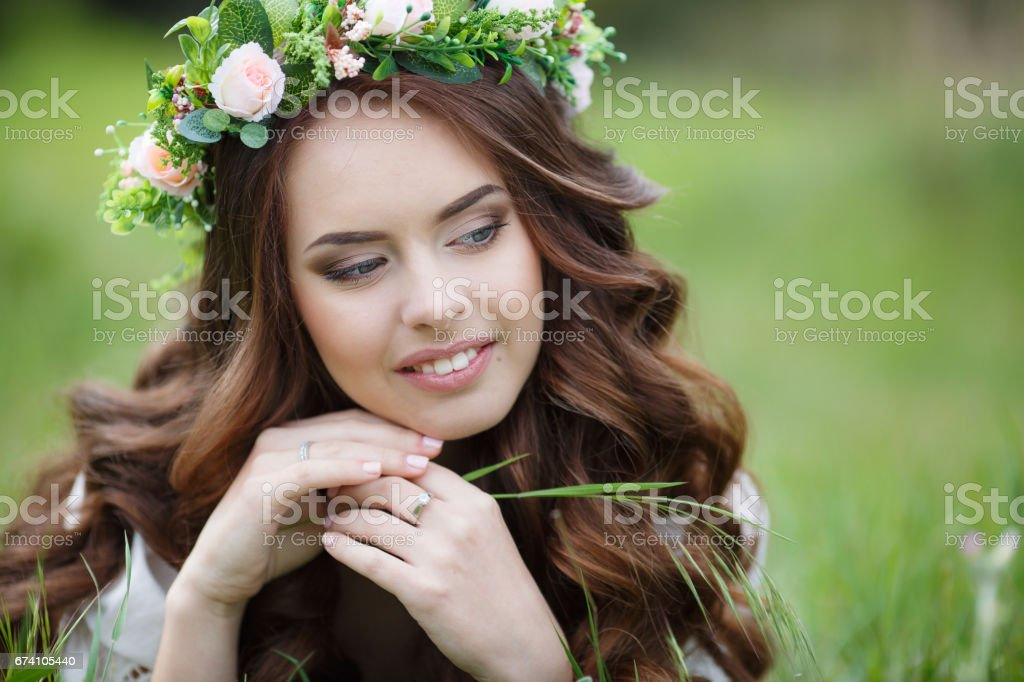 Spring portrait of a beautiful woman lying on green grass royalty-free stock photo