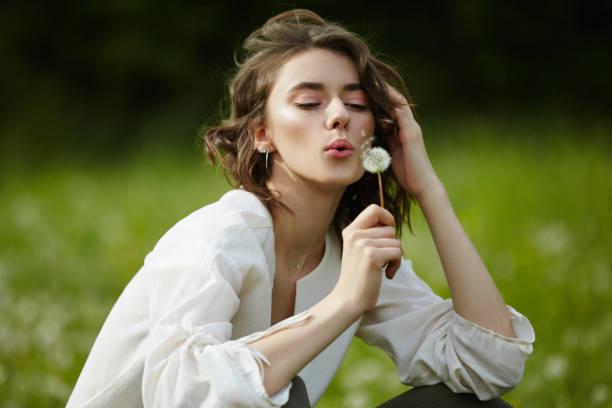 Spring portrait of a girl sitting in a field on the grass among picture id1171715662?b=1&k=6&m=1171715662&s=612x612&w=0&h=qpxchvadhjkqhzelqzt6bgk2kknmfsi4s3eijxhtvhu=