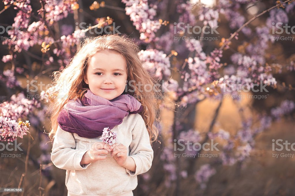 Spring portrait of child girl with flower royalty-free stock photo
