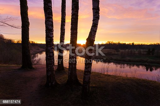 istock Spring. river. sunrise. sunset. Dawn over the river photographed in early spring 688157474