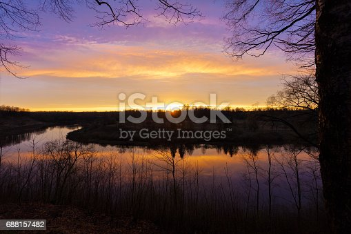 istock Spring. river. sunrise. sunset. Dawn over the river photographed in early spring 688157482
