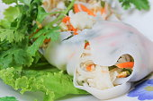 spring rolls with Onion and fresh vegetable on a wooden table