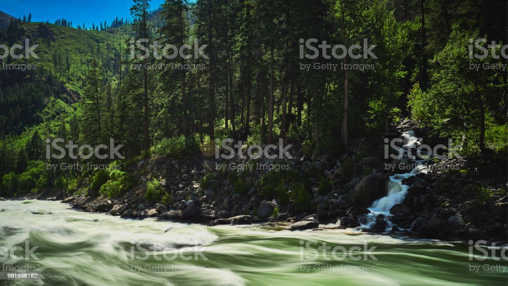 Spring runoff near overflow levels on the Icicle River in North Central Washington stock photo