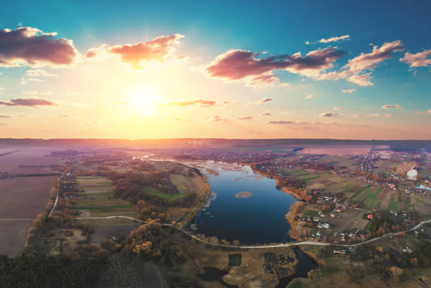 spring rural landscape in the evening, aerial view. panoramic view of the river on the meadow at sunset. panorama from 9 images - barragem do roxo imagens e fotografias de stock