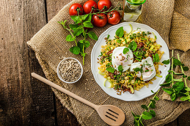 Spring salad of lentils with poached egg stock photo