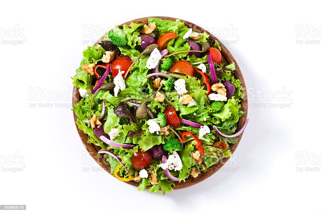 Spring salad shot from above on white background stock photo