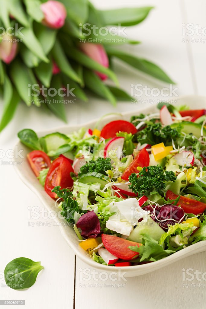 Spring salad with fresh vegetables from radishes and kale royalty-free stock photo